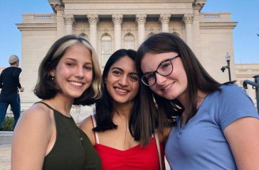 Stuti Bhardwaj (center) in front of the Wisconsin state capitol during her two-week stint on campus.