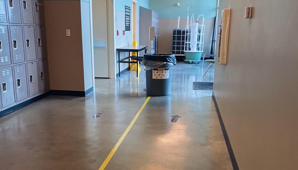 Tape separates a hallway for students walking in opposite directions (Photo by Megan Kozlowski)
