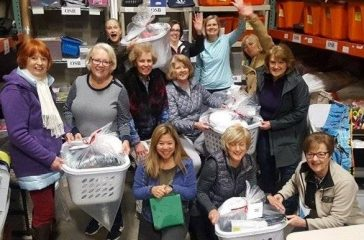 Volunteers at The Sophia Way help to organize a storage closet pre-pandemic. (courtesy)