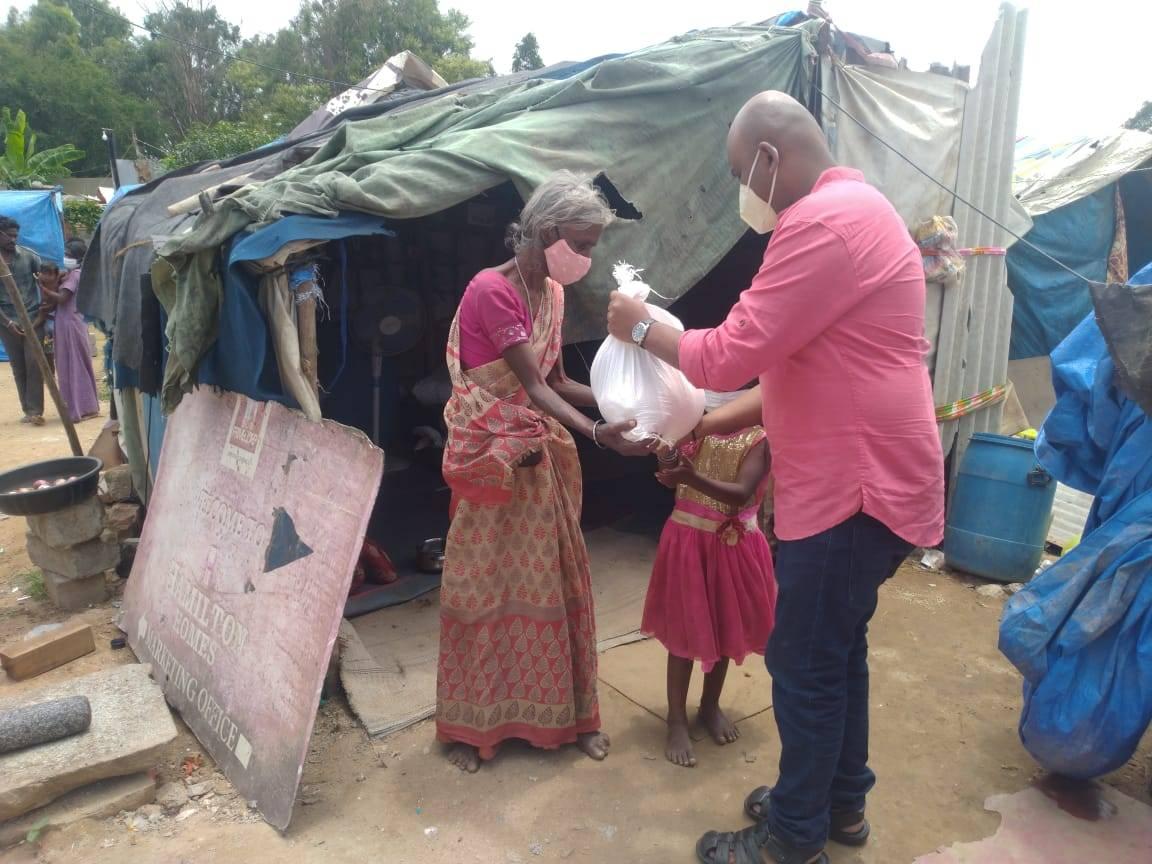 A man donates supplies to a family.