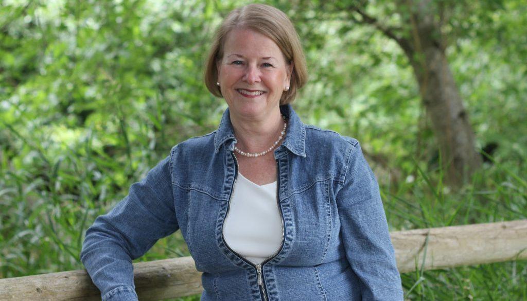 Karen Howe with trees behind her.