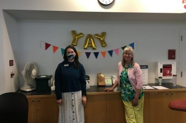 Librarians welcoming patrons.