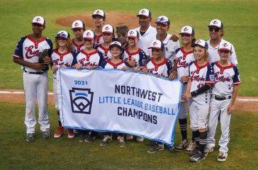 Eastlake team with winning banner.