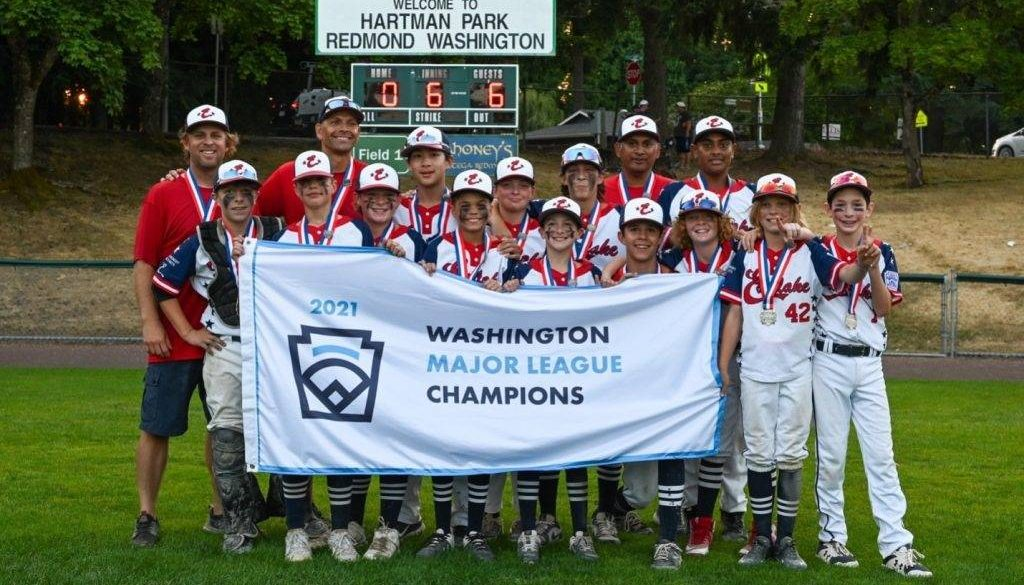 Baseball team posing with championship banner