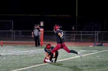 Eastlake player kicks a field goal.