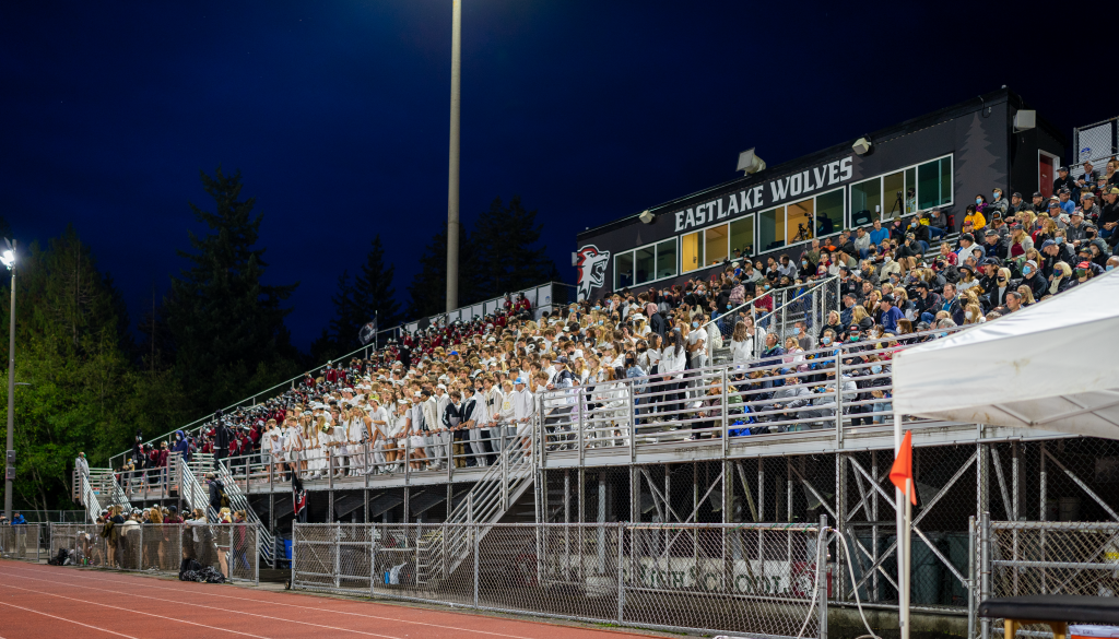 Students cheering on Eastlake football stands.