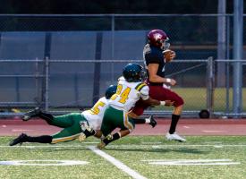 Eastlake player runs past Kentridge's defense.