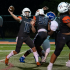 Eastside Catholic quarterback throwing ball.
