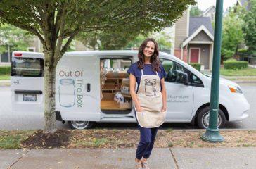 Aline Bloch in front of van.